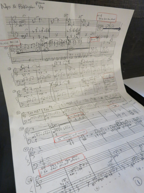 Xintong Wang makes notes to improve the score.